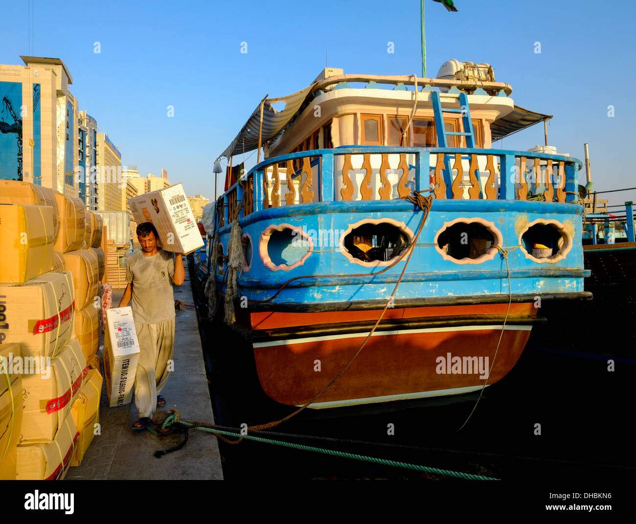 Loading cargo onto Dhows at The Creek river in Dubai United Arab Emirates UAE - Stock Image