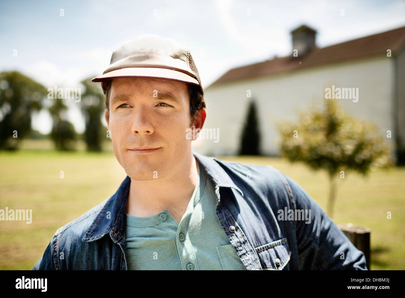 A man in a baseball cap on an organic farm in New York State. - Stock Image
