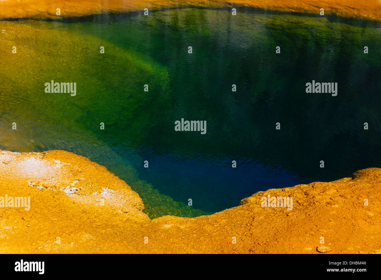 Detail of colourful water mineral deposits and rock formations from Midway Geyser, in Yellowstone National Park. - Stock Image