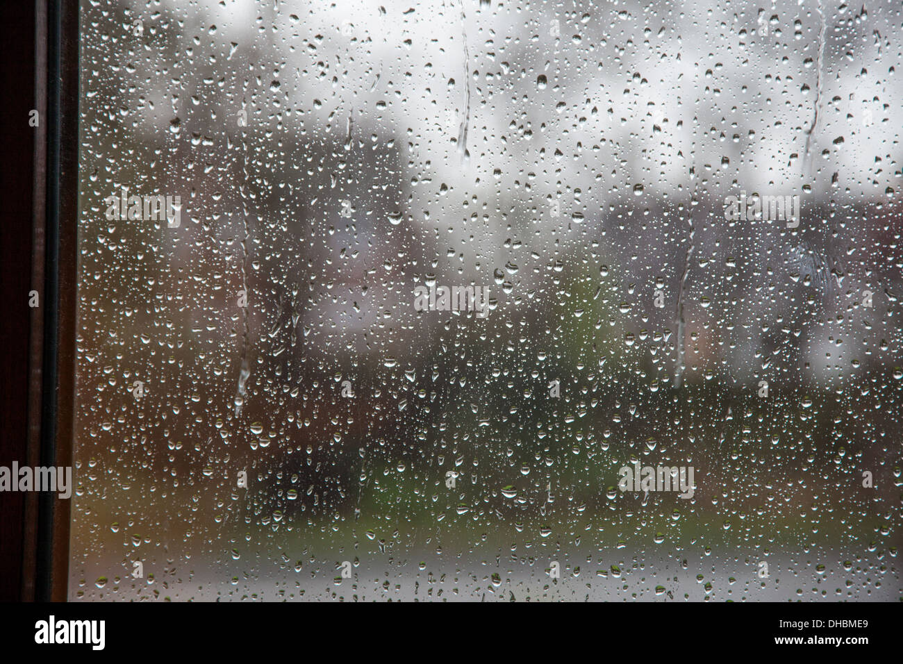 Rain drops on a glass window pane - Stock Image
