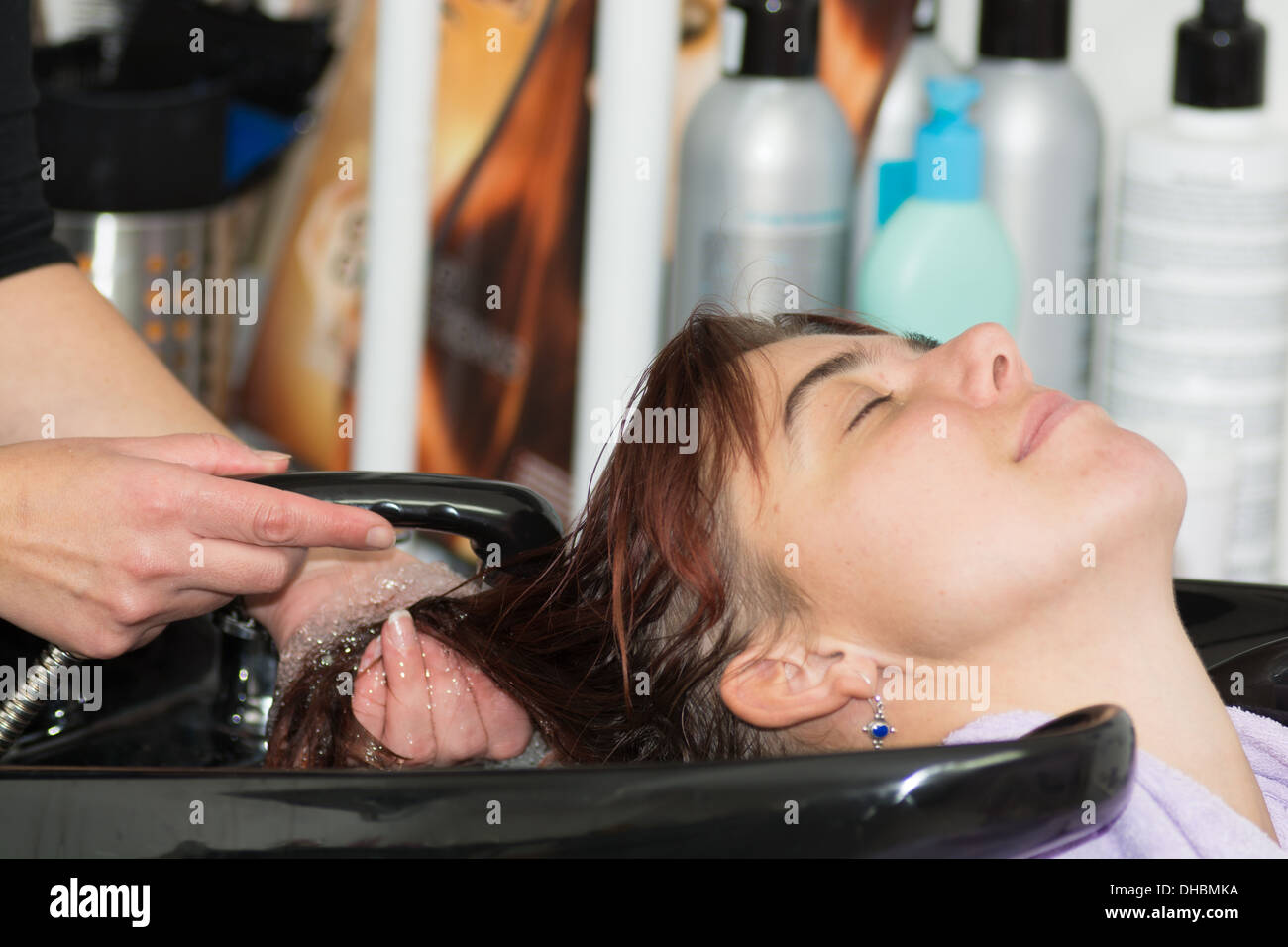 hair care - young woman enjoing hair washing at a hairdresser Stock Photo