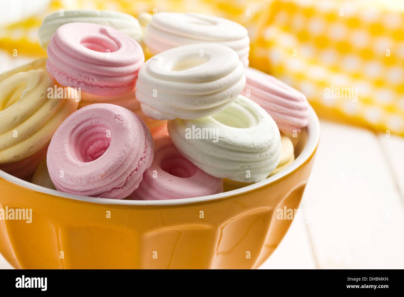 colorful meringues in ceramic bowl - Stock Image
