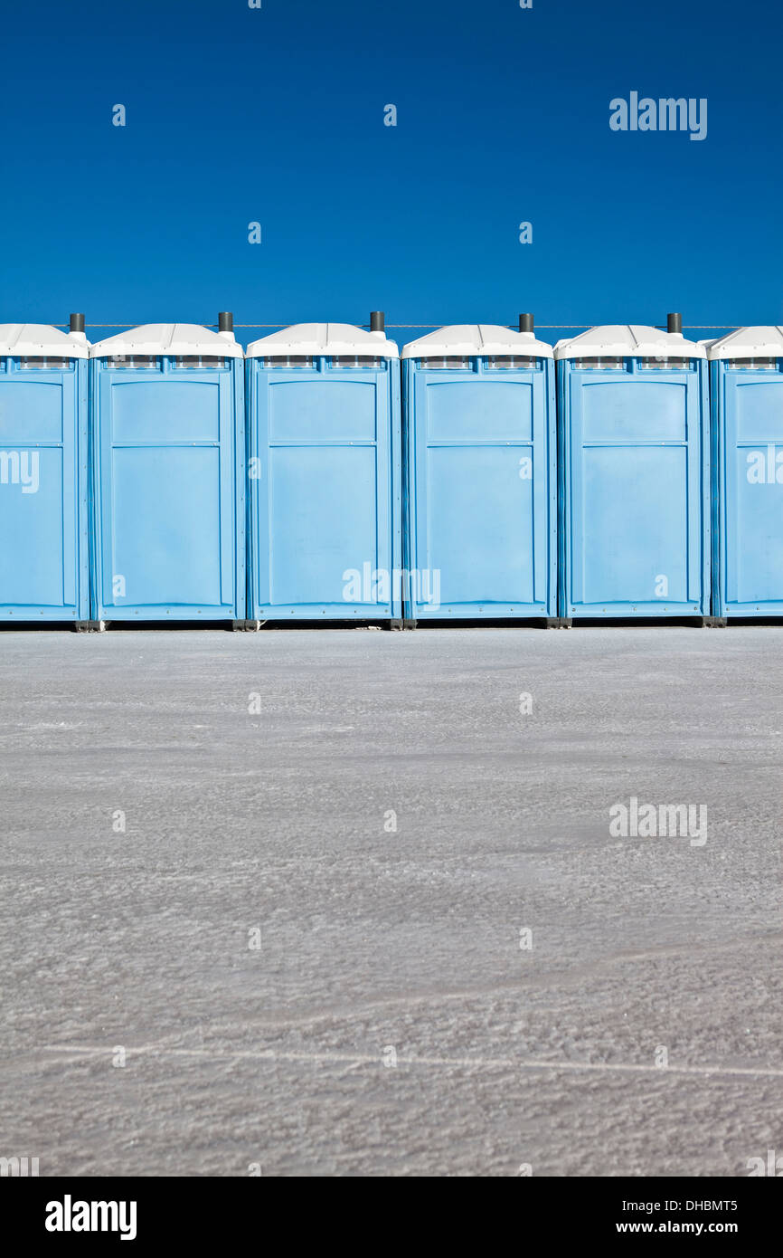 Row of portable toilets on Bonneville Salt Flats, during Speed Week - Stock Image