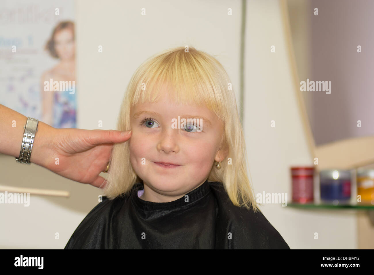 hair care - little girl at a hairdressing salon - Stock Image