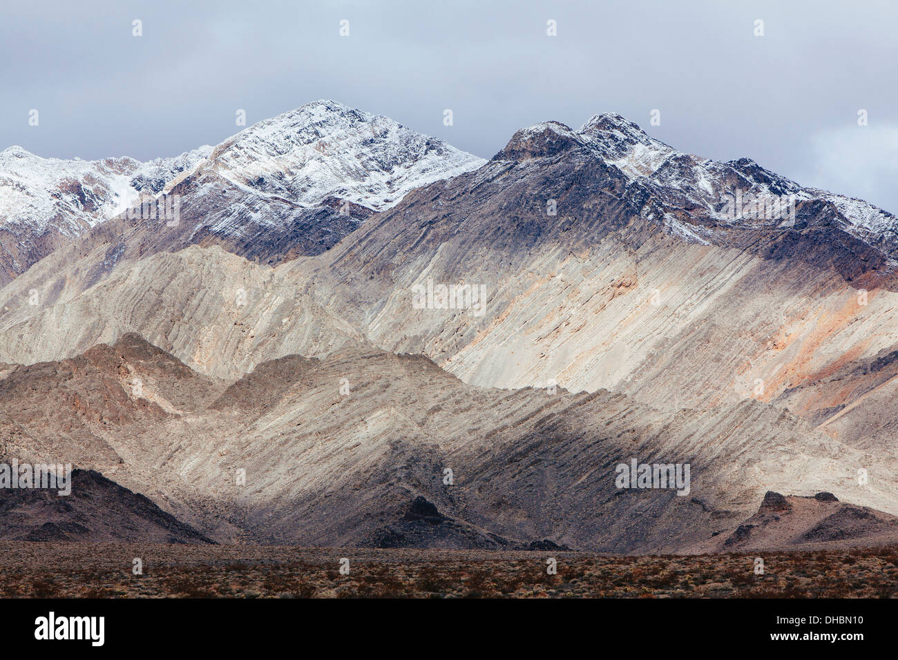 Snow covered mountains and ominous sky, Panamint Mountains, Death Valley NP - Stock Image