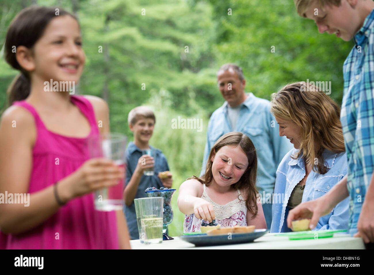 Organic Farm. An outdoor family party and picnic. Adults and children. - Stock Image