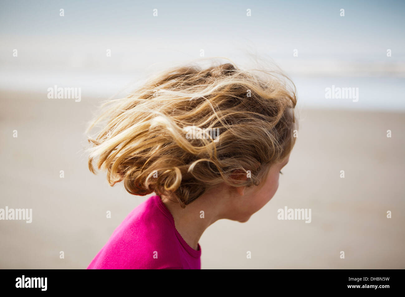 View of from behind of six year old girl on beach, Long Beach Peninsula - Stock Image