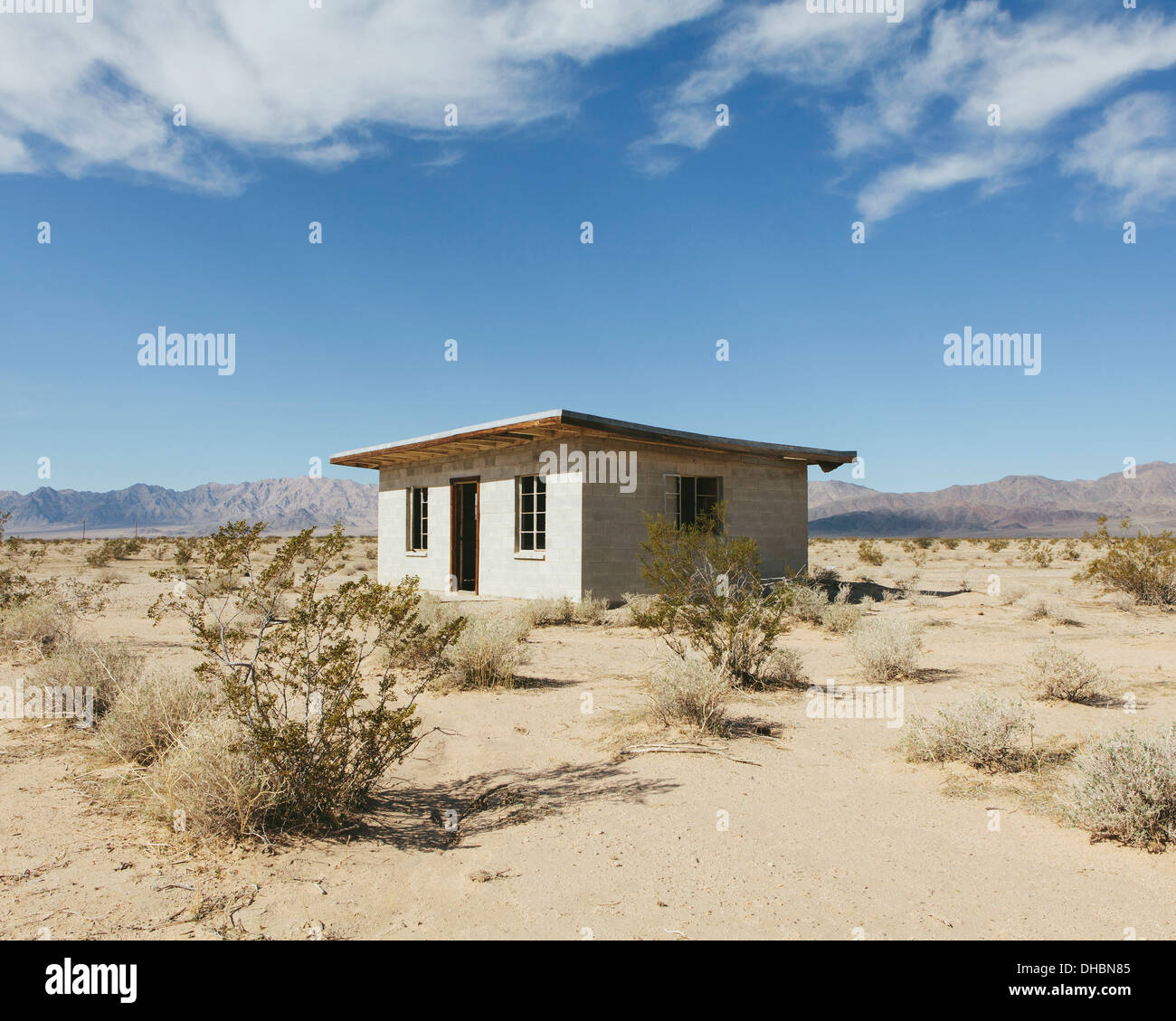A small abandoned building in the mojave desert landscape for Www newhouse com