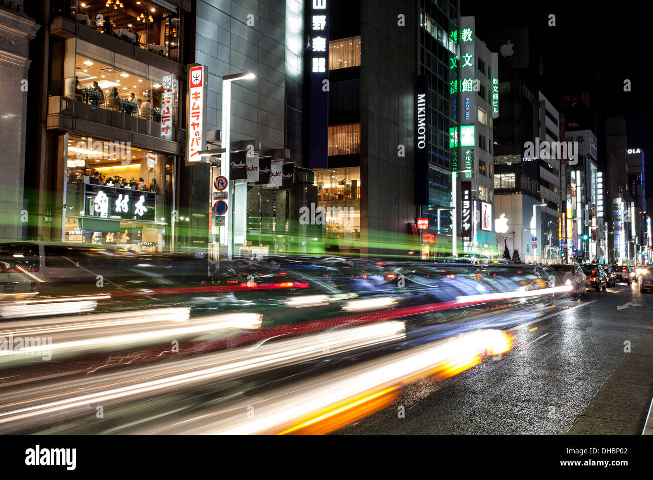 A color photograph of the traffic at night in Tokyo, Japan - Stock Image