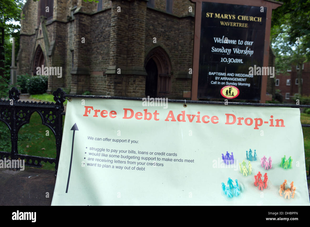 Free debt advice sign outside a church in Wavertree, Liverpool, England, UK. 2013. - Stock Image