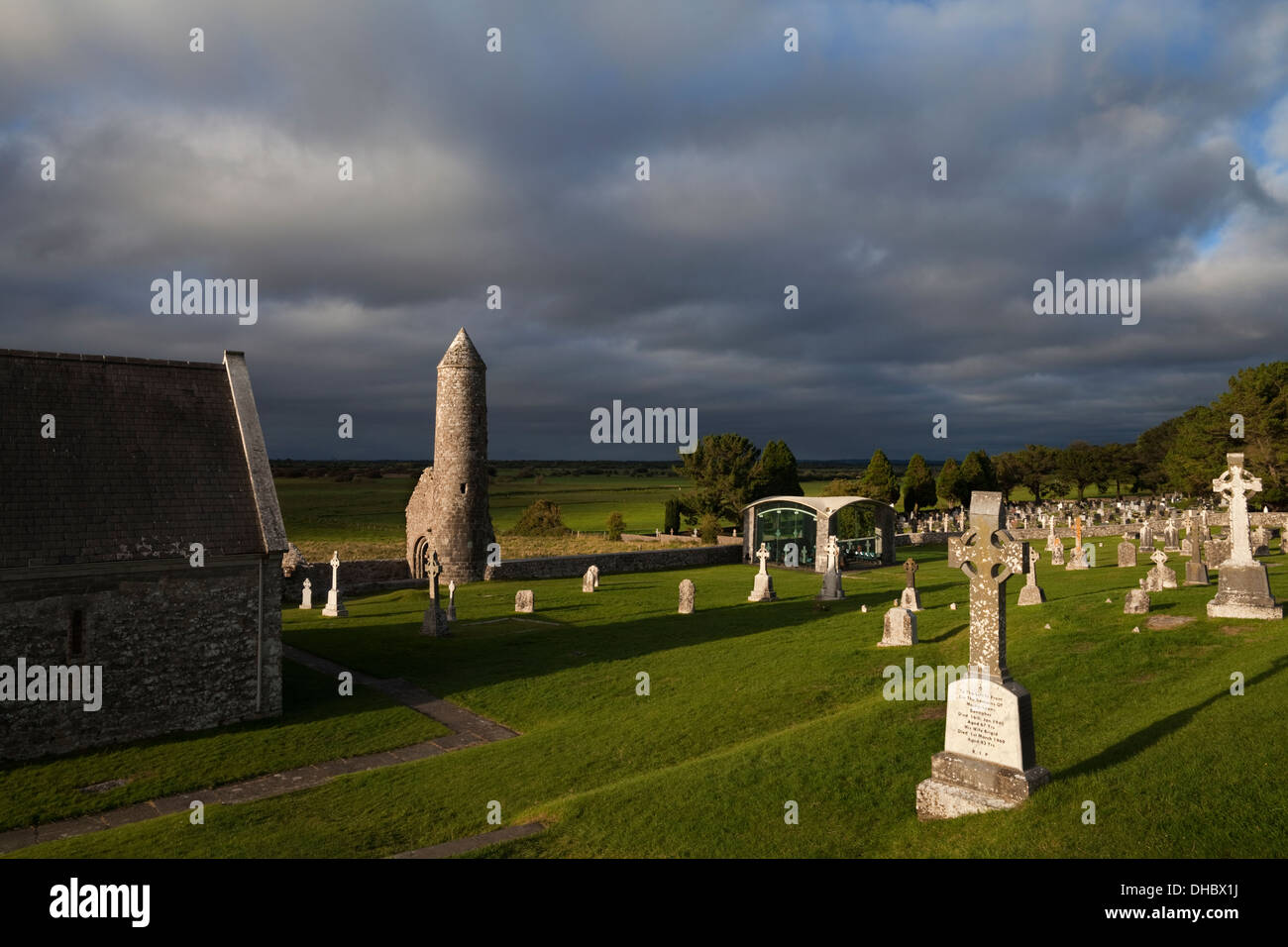 The West Church, Round Tower and Modern Chapel, Clonmacnoise Ecclesiastical Centre, County Offaly, Ireland - Stock Image