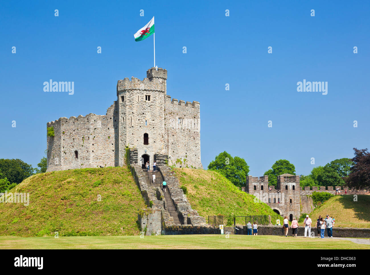 inside the grounds of Cardiff Castle with the Norman Keep flying the welsh flag Cardiff South Glamorgan Wales UK GB EU Europe - Stock Image