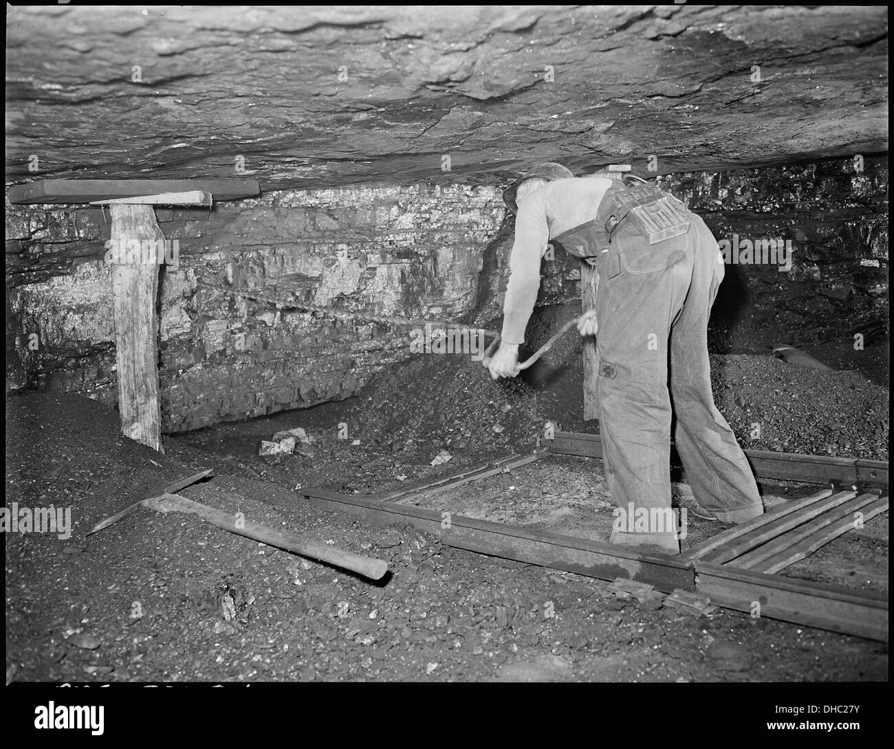 Harry Fain, coal loader, drills coal with hand auger. Powder charges are then placed and ignited. Inland Steel... 541482 - Stock Image