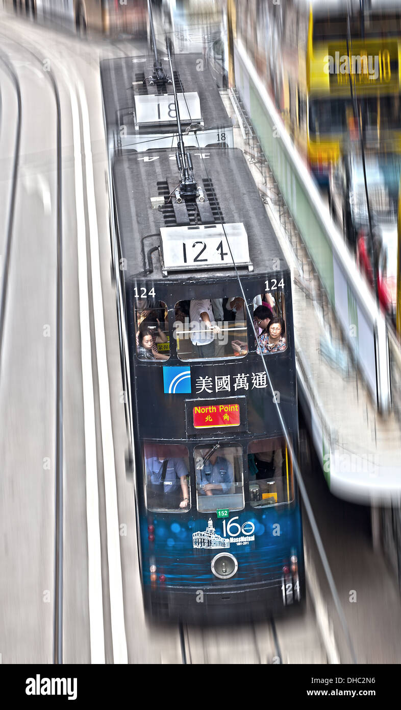 A tram in Hong Kong, China. The image is color and has motion blur. - Stock Image