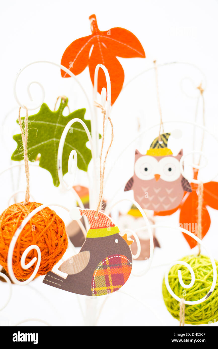 Crafty Christmas tree with cute folk art decorations - Stock Image