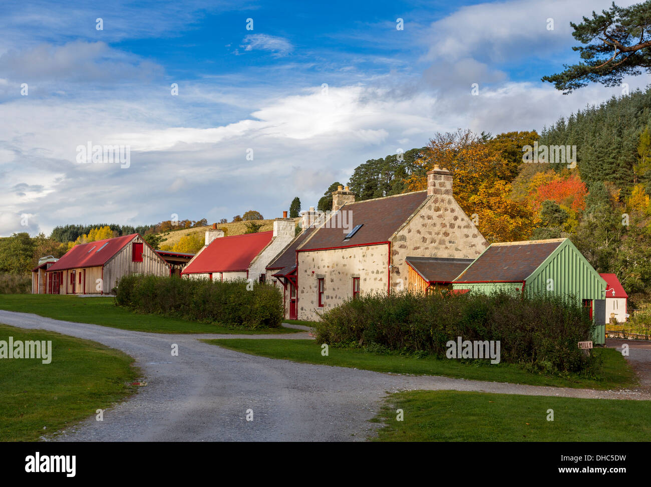 OLD RENOVATED WOOL MILL IN KNOCKANDO SPEYSIDE SCOTLAND WITH AUTUMNAL TREE COLOURS - Stock Image