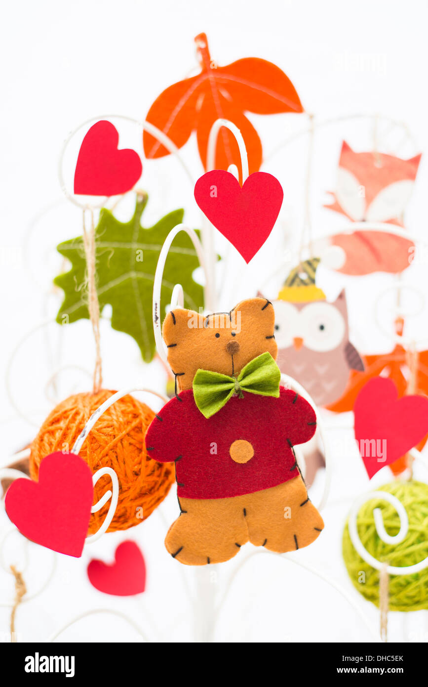 Crafty Christmas tree with folk art decorations and cute felt cat - Stock Image