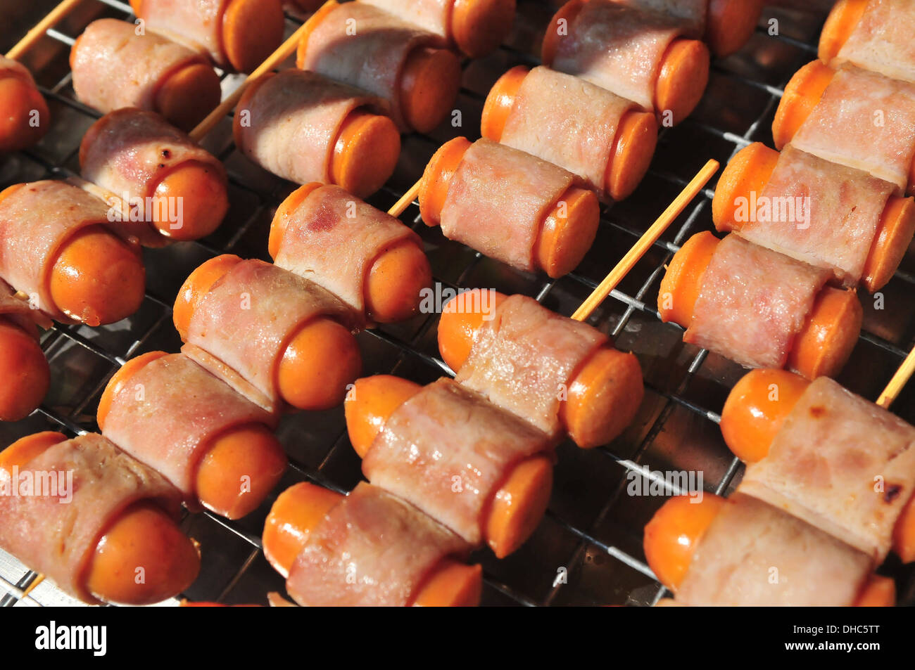 Thailand street food - Thai bacon-wrapped hot dogs - Stock Image