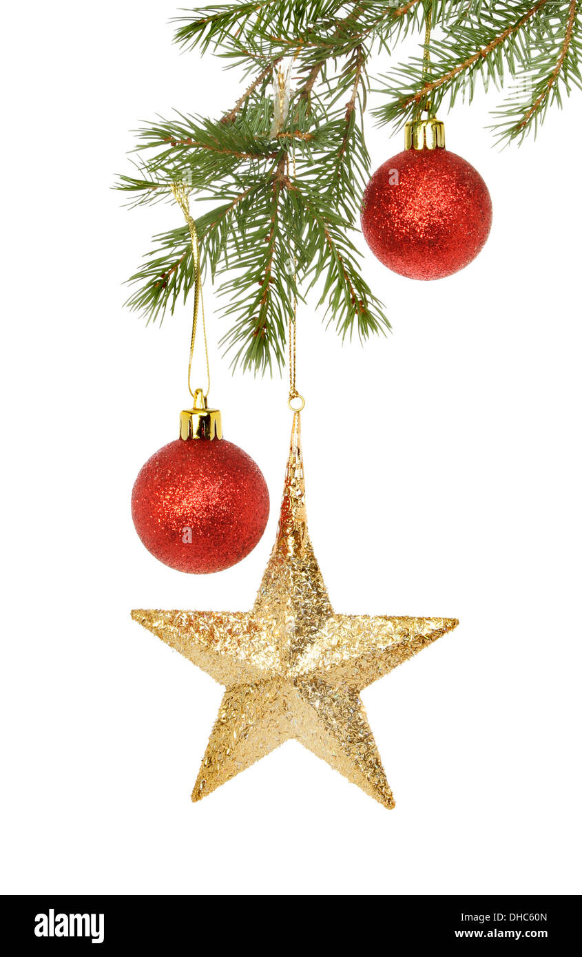 bdcf6af23af1 Gold star and red glitter baubles hanging in a Christmas tree isolated  against white