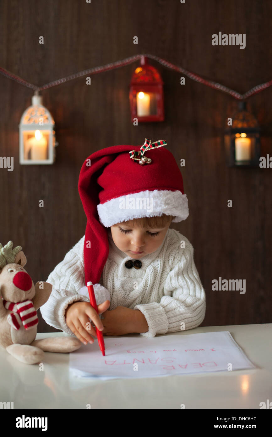 Boy Writing Letter To Santa Stock Photo   Alamy