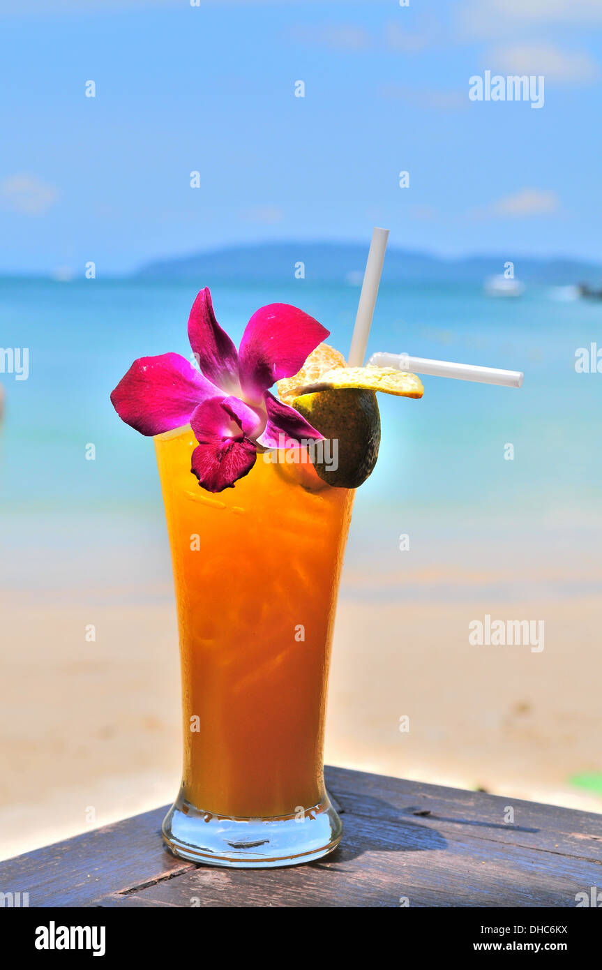 Orange cocktail by the beach - Stock Image