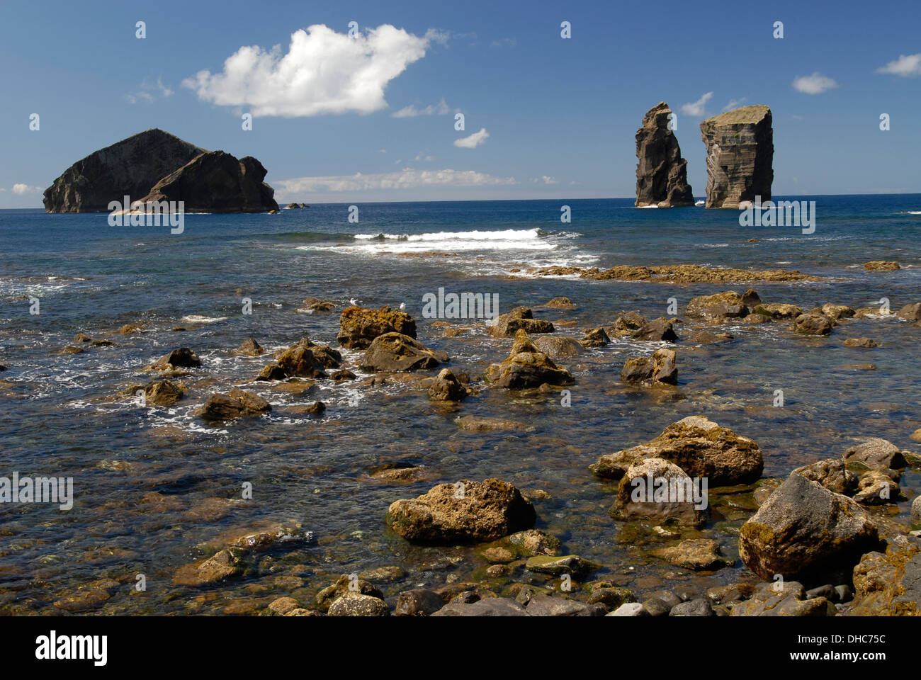 Rocks at the coastline in Mosteiros and Ilheu dos Mosteiros, Sao Miguel Island, Azores, Portugal - Stock Image