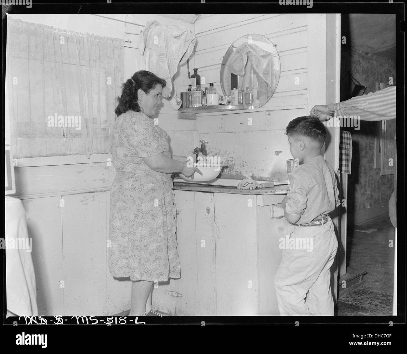 Family In Kitchen Black and White Stock Photos & Images - Alamy