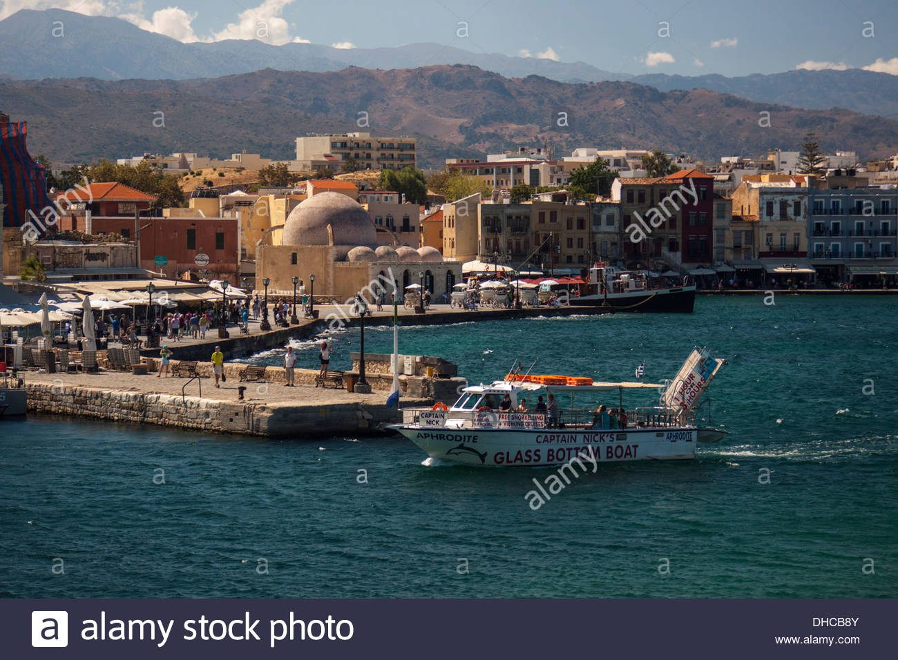 Glass bottom boat entering Chania horbour on Crete - Stock Image