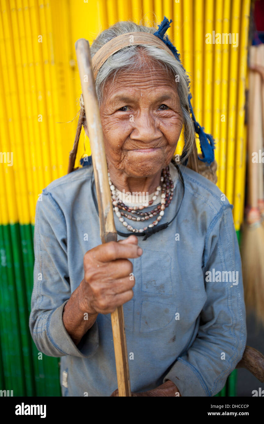 A Hanunoo Mangyan woman stops for a portrait outside the Central Market in Mansalay, Oriental Mindoro, Philippines. - Stock Image