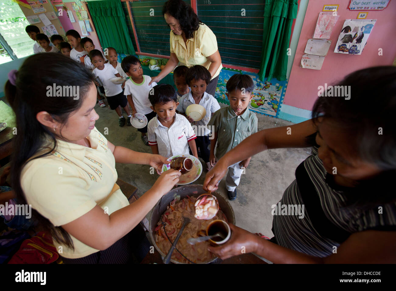 Children wait for a free lunch during a feeding program event at Wasig Elementary School in Wasig, Oriental Mindoro, Stock Photo