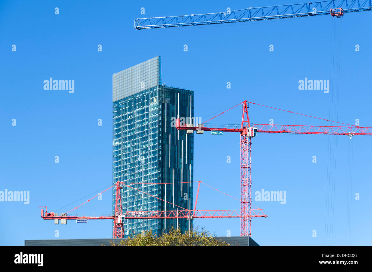 Beetham Tower and tower cranes of the First Street construction site, Manchester, England, UK.  Also called the Hilton Tower. - Stock Image