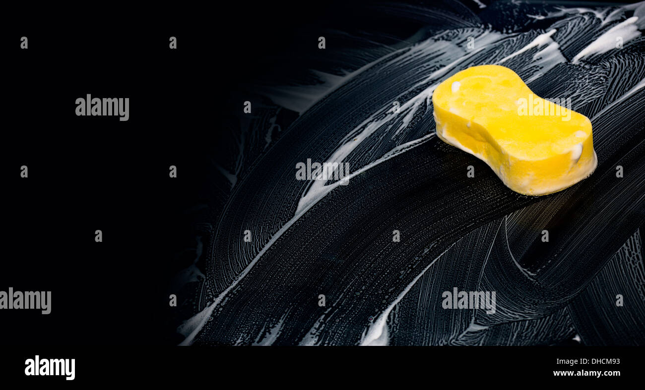 sponge over the car for washing - Stock Image