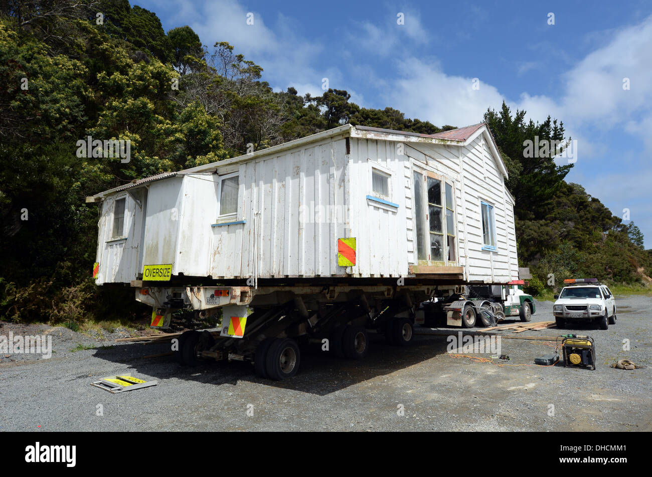 Transporting an old house to a new location in New Zealand Stock Photo