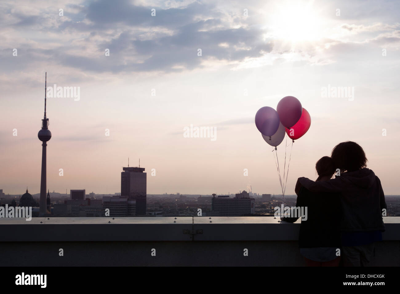 Germany, Berlin, Young woman on rooftop terrace - Stock Image