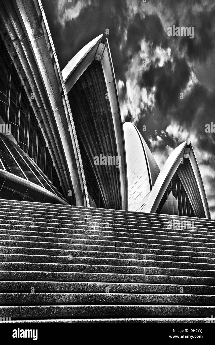 A black and white artistic photograph of the sydney opera house in