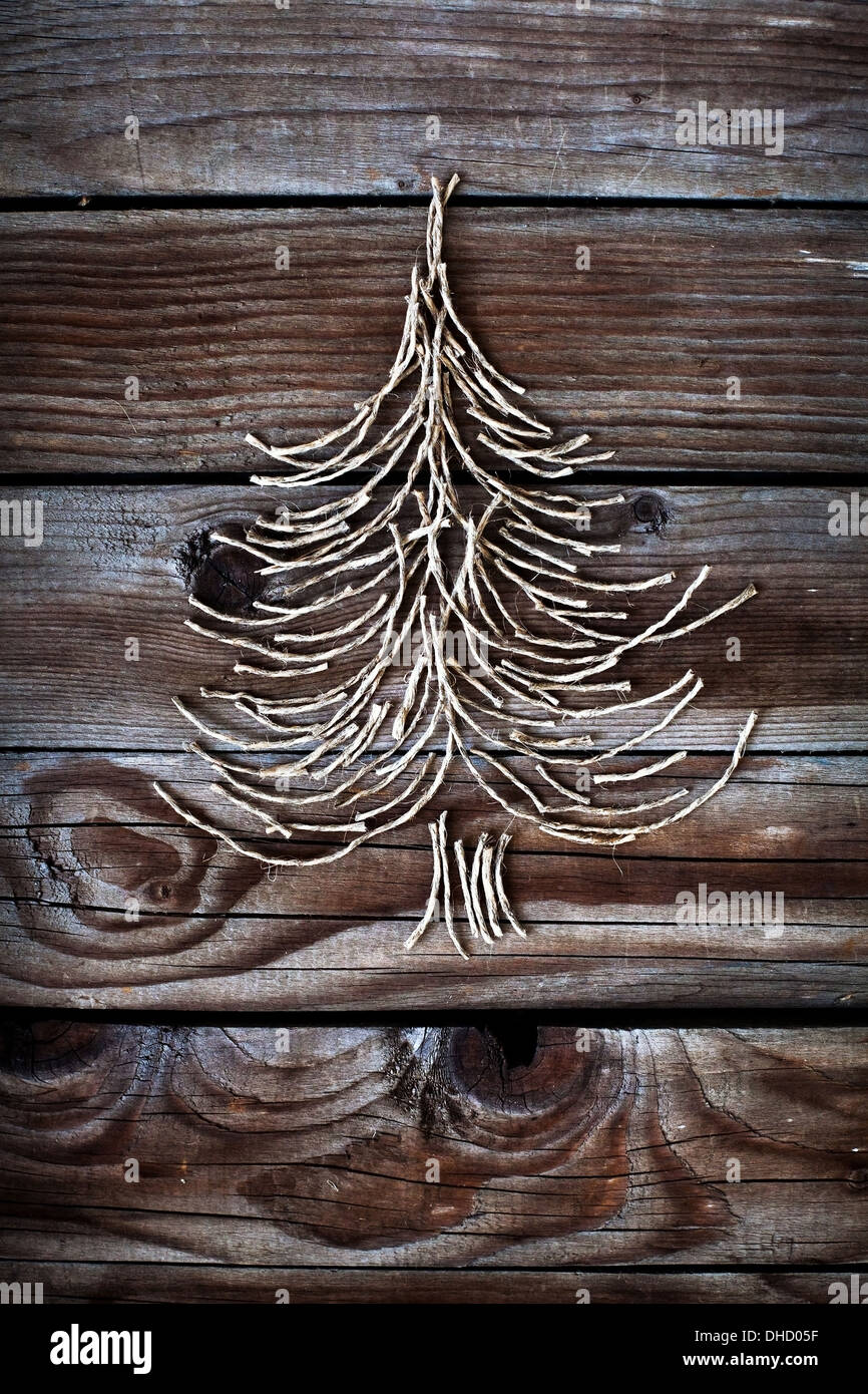 christmas tree on wooden background - Stock Image