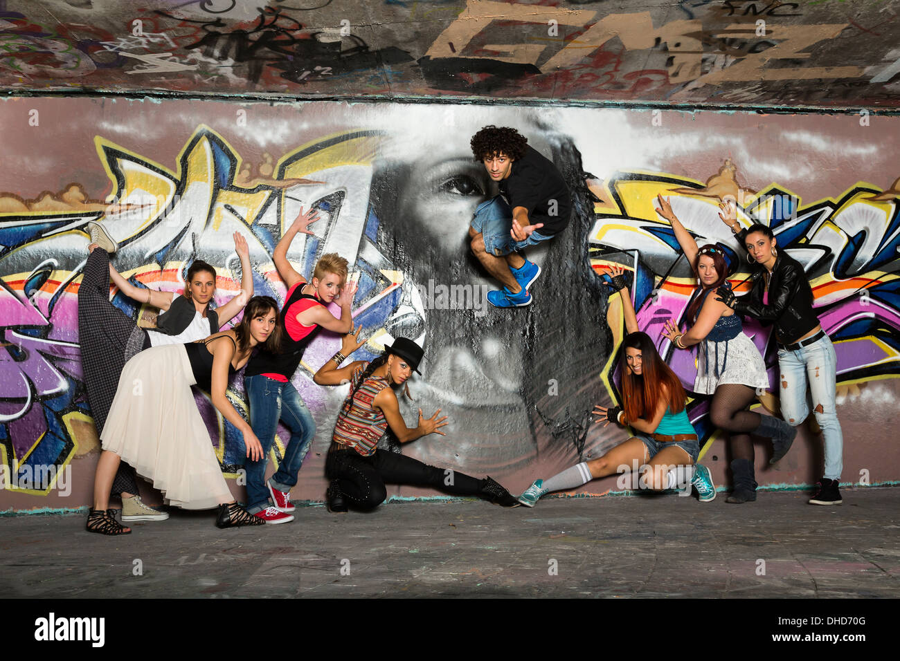 Germany, Stuttgart, Hall of Fame, Group of Hip Hop dancers at airbrush wall Stock Photo