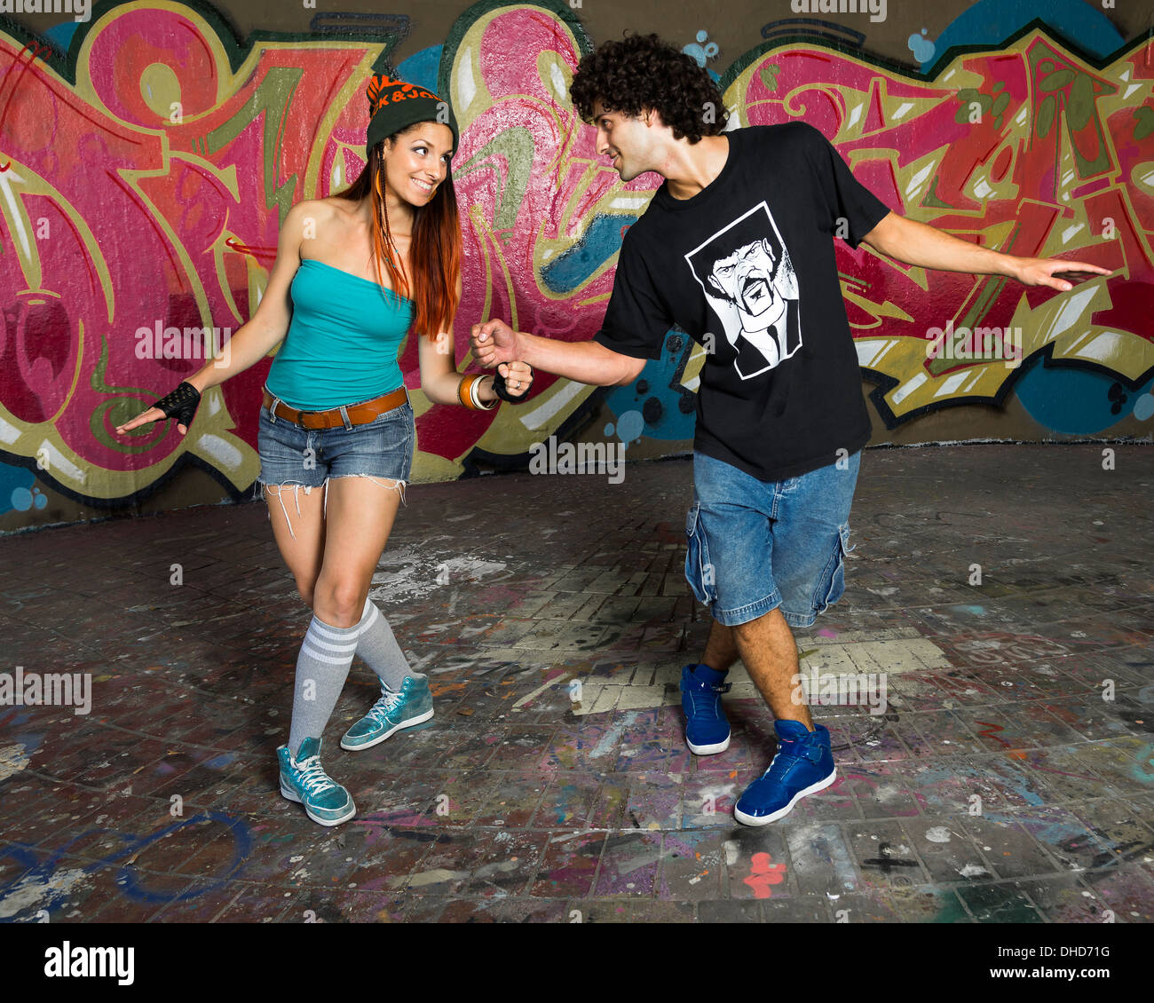 Germany, Stuttgart, Hall of Fame, Two Hip Hop dancers at airbrush wall Stock Photo