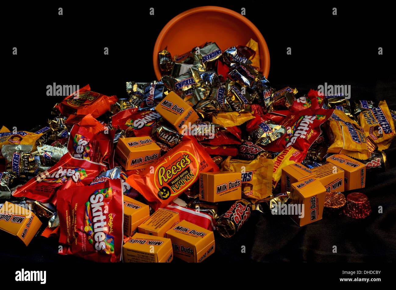Halloween Candy Falling Out of Bowl - Stock Image