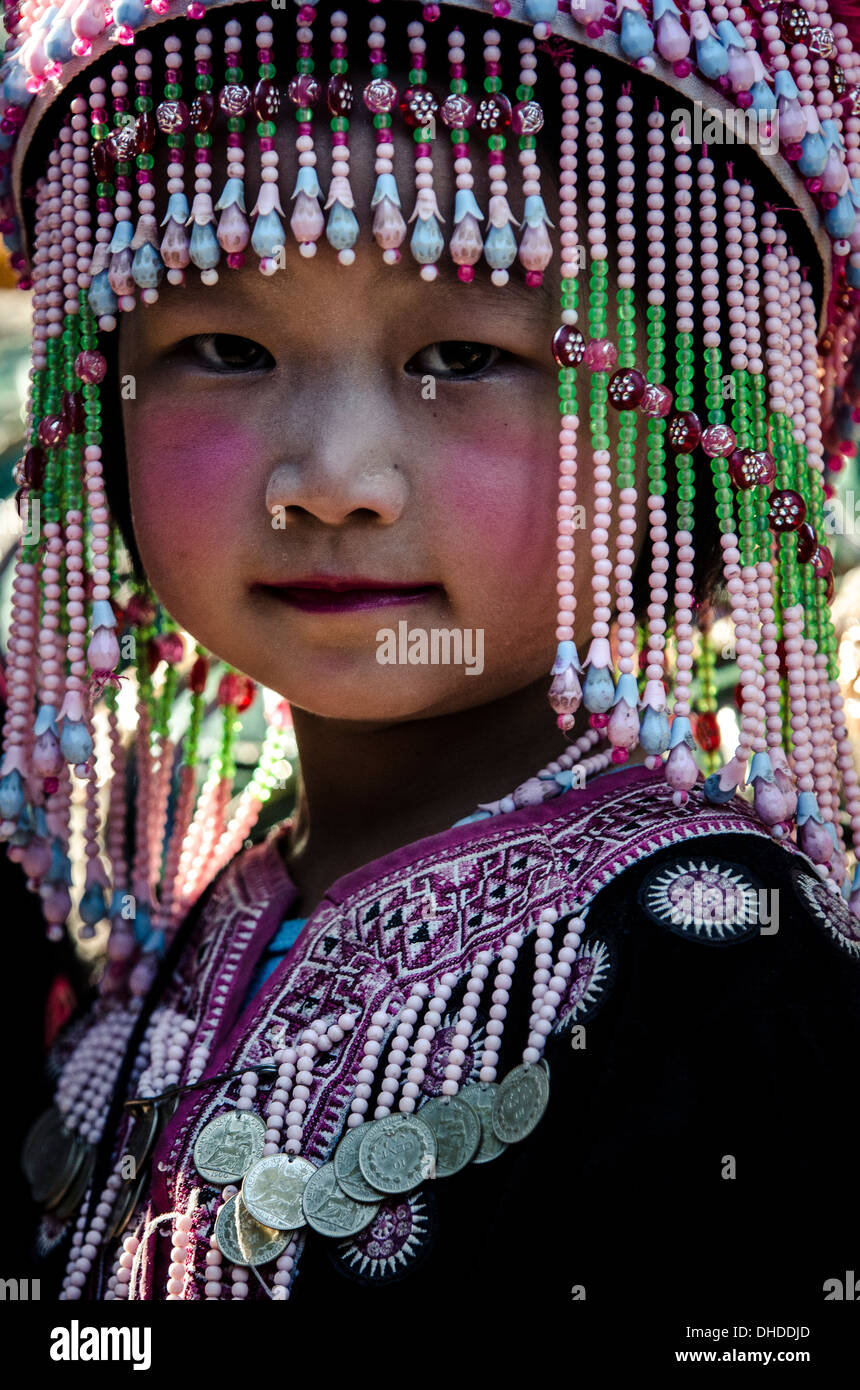A girl in traditional hilltribe costume, Wat Phra That Doi Suthep, Chiang Mai, Thailand, Southeast Asia, Asia - Stock Image