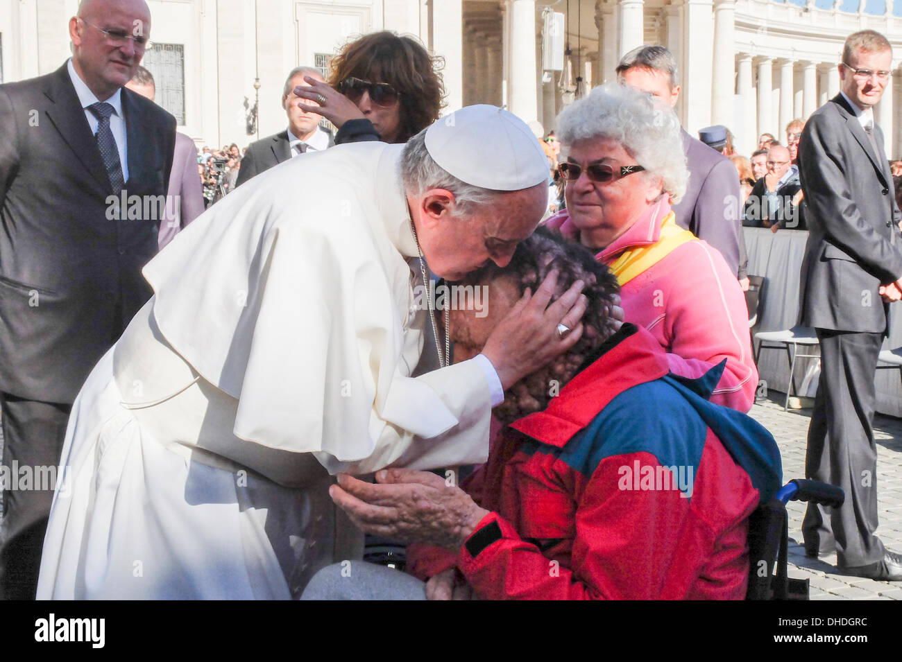 Vatican, Rome, Italy. 06th Nov, 2013. Vatican Pope Francis, general audience 06 November 2013 Pope Francis hug and bless a person sick of neurofibromatosis during the general audience of 6 November in St Peter square © Realy Easy Star/Alamy Live News - Stock Image