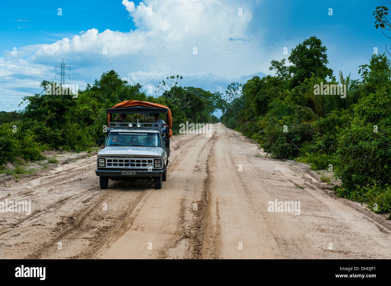 Jeep with tourists driving through the Pantanal, UNESCO World Heritage Site, Brazil - Stock Image