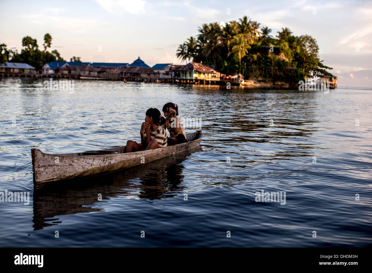 Two girls in a canoe, Togian Islands, Sulawesi, Indonesia, Southeast Asia, Asia - Stock Image