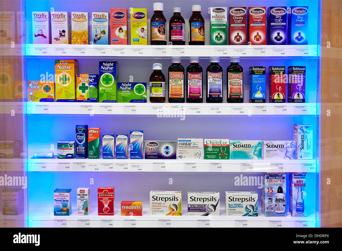 Cold flu remedies and  medicine pictured on a pharmacy shelf - Stock Image