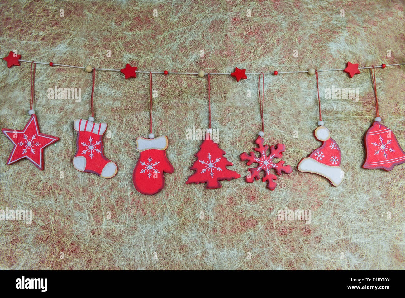 rustic shabby chic christmas decorations hanging against golden background