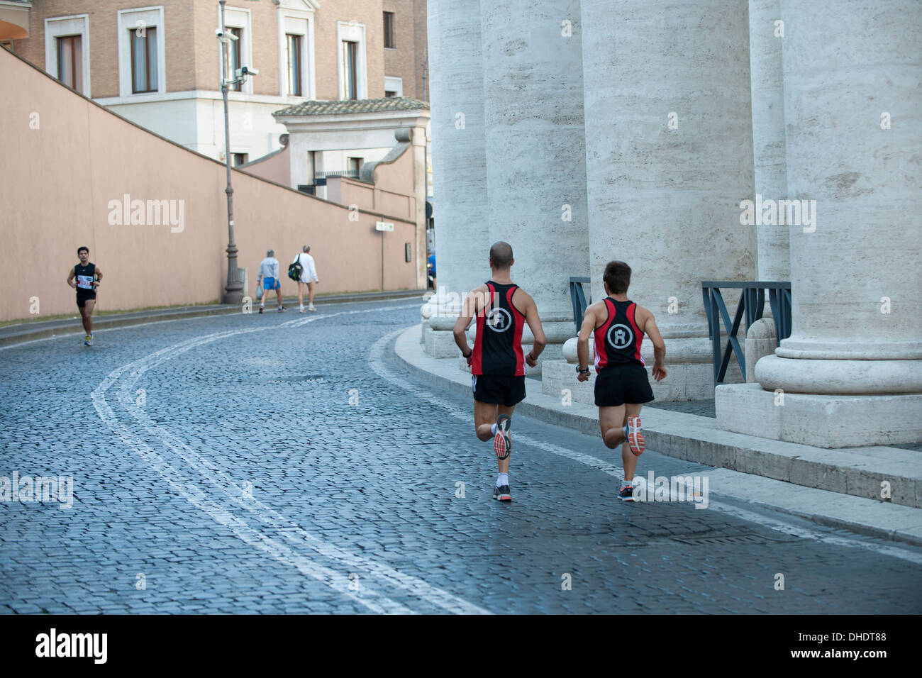 Athletes do warm up before race in Vatican city - Stock Image