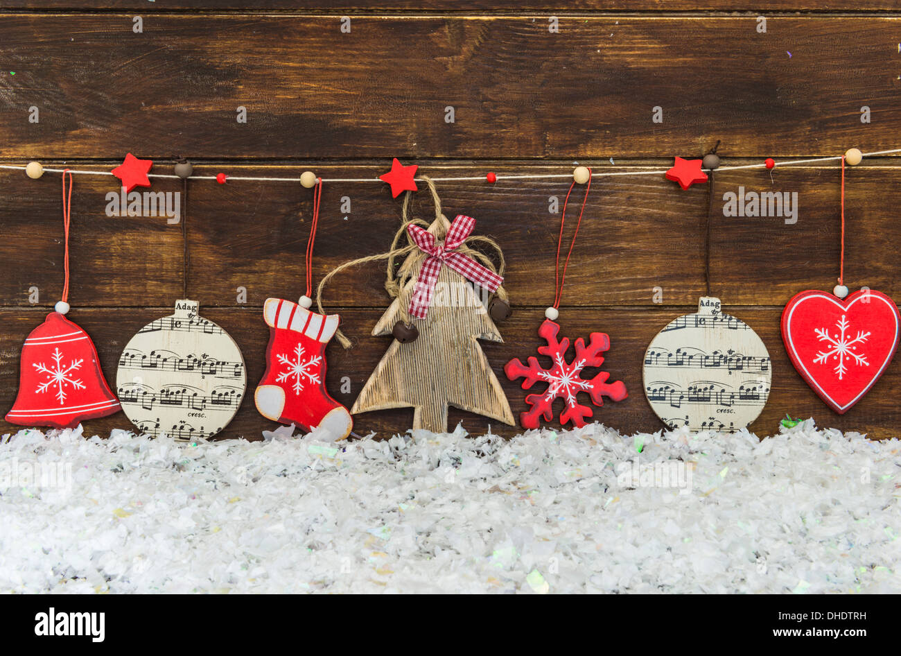 rustic shabby chic christmas decorations hanging on brown wooden board stock image