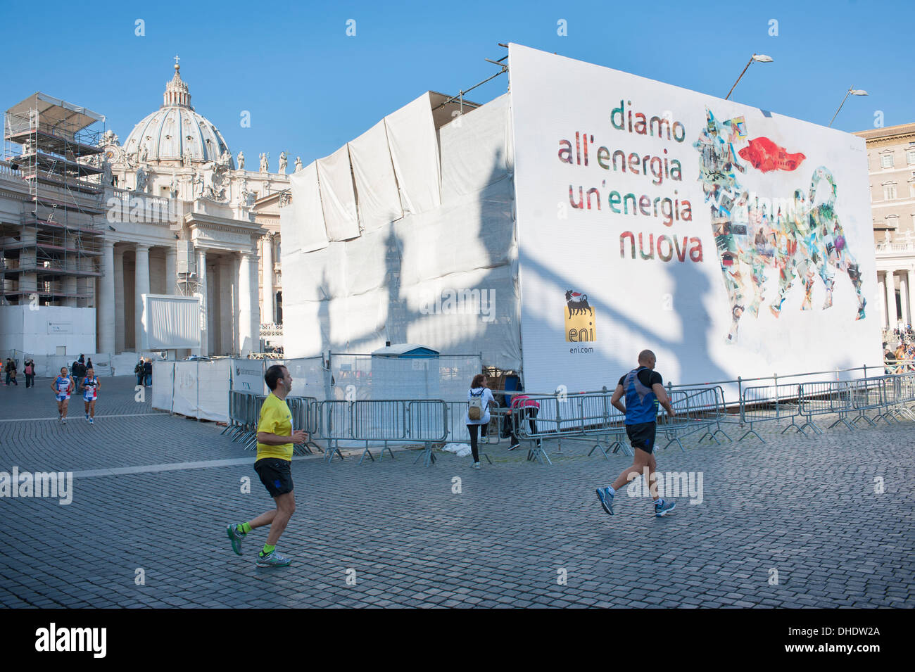 Athletes do warm up before race in Saint Peter's square - Stock Image
