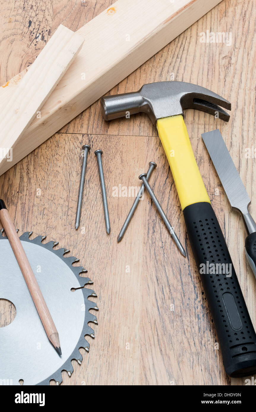 A selection of woodworking and carpentry tools placed on a wood background - studio shot - Stock Image