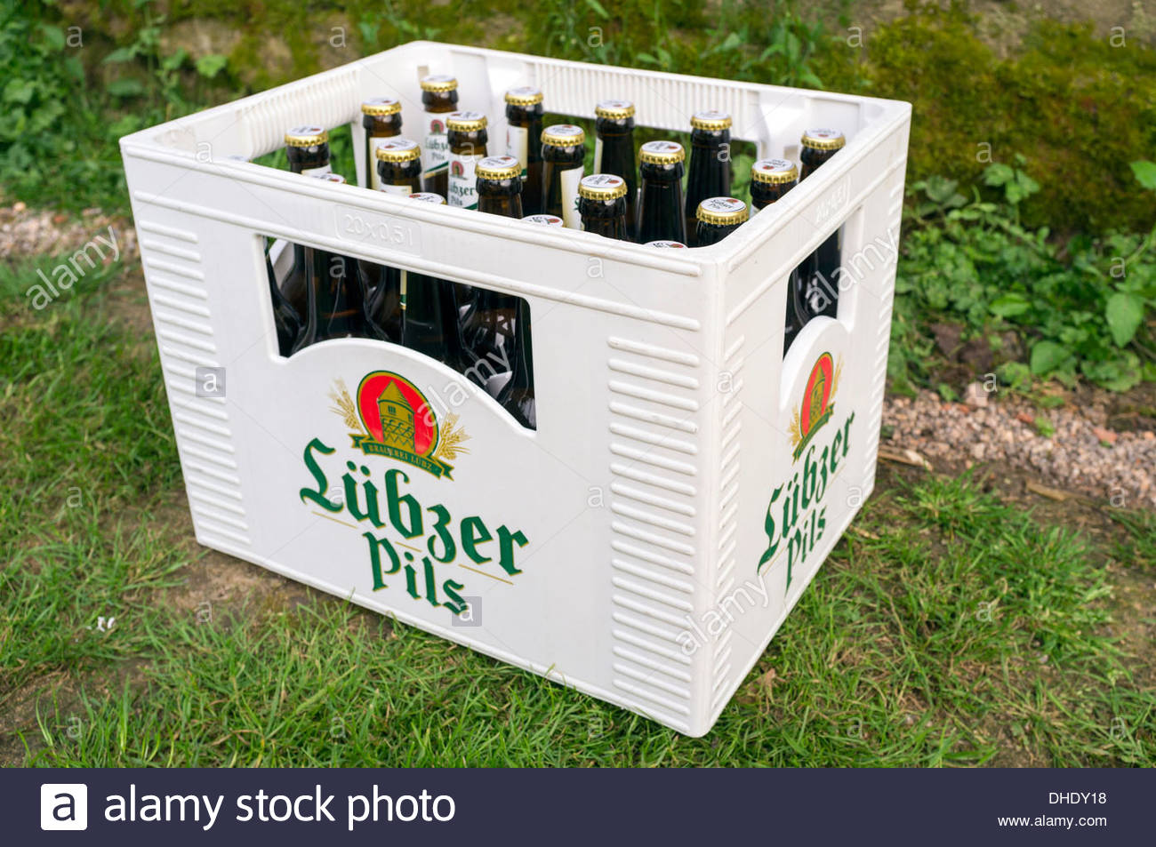 German Beer, Lübzer Pils, beer bottles in plastic bierkasten case - Stock Image